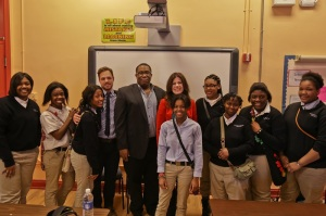 Eric Owens and Ana María Martínez pause for a photo with Chicago high school kids
