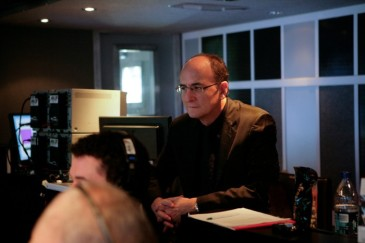Metropolitan Opera General Manager Peter Gelb monitors the 'Live in HD' transmission